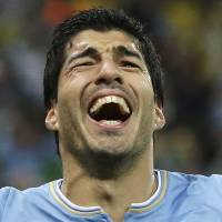 Barcelona signs bad boy Suarez