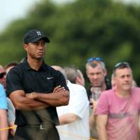 This isn't going well: Tiger Woods looks on from the 10th tee during the second round in Hoylake, England. Woods shot a 77 and made the cut by a slim margin. | AFP-JIJI
