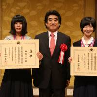 Shiho Fukushima (left) and Shiho Soma (right) pose with Haruhisa Handa, the chairman of the International Foundation for Arts and culture, after receiving Prime Minister Awards at a Tokyo hotel July 5. | COURTESY OF IFAC