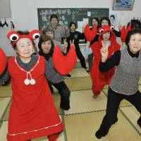 Canny: Among other things, your dues fund local groups like this chōnaikai women's circle in Abashiri, Hokkaido, seen here celebrating the local delicacy through exercise. | KYODO