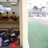Playing it safe: Children play in an indoor sand pit at a kindergarten in Koriyama, about 50 km from the Fukushima No. 1 nuclear plant. The city recommended that children aged 3 to 5 limit their time outdoors to 30 minutes per day in the wake of the 2011 nuclear disaster. The limits were lifted in 2013, but many of the region's kindergartens continue to adhere to them because of parents' concerns. | REUTERS