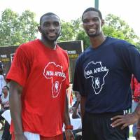 Clinic instructors: Dzaflo Larkai (left) and Miami Heat star Chris Bosh said they enjoyed working with teenage basketball players last weekend in Ghana. | NBA AFRICA