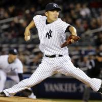 Stunning news: New York Yankees ace Masahiro Tanaka, who leads the major leagues with 12 victories this season, may need reconstructive surgery on his pitching elbow due to a torn ligament.  | AP