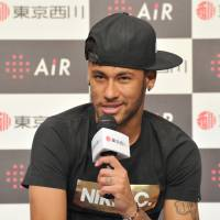 Positive outlook: Neymar says he's 'feeling better and better all the time' weeks after suffering a serious back injury against Colombia at the World Cup. Neymar visited Tokyo on Thursday to shoot an advertisement for a bedmaker company. | YOSHIAKI MIURA