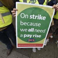 Public workers strike across U.K. over austerity pay cuts