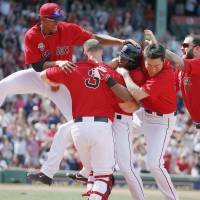 In the clutch: The Red Sox celebrate their walk-off victory over the Orioles on Saturday. | AP