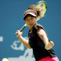 Bank raid: Sixteen-year-old Naomi Osaka plays a shot during her first-round win over Samatha Stosur at the Bank of the West Classic on Monday. | KYODO