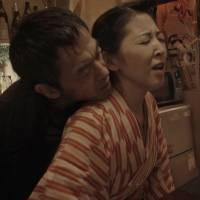 "Staged reality: Former pink-film actress Kyoko Hayami, who manages a real bar in Shinjuku's cramped Golden-gai district, stars as a local proprietress in ""Tsugunai: Shinjuku Golden-gai no Onna (Unlucky Woman's Blues)."" 