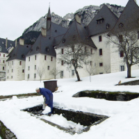 "Only the sound of work: A Carthusian monk shovels snow outside the Grande Chartreuse monastery in the documentary ""Into Great Silence."""