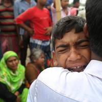 Rescuers battle current in hunt for 200 people missing in Bangladesh ferry disaster