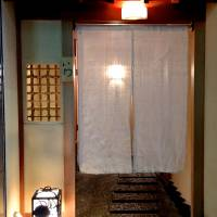 The genkan entrance of Sushi Iwa in Ginza. | ROBBIE SWINNERTON
