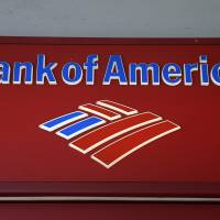 Signage from a Bank of America branch is viewed in downtown Miami, which was hit hard when the U.S. housing market collapsed under the weight of toxic loans. | AP