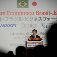 Prime Minister Shinzo Abe delivers a speech during the Brazil-Japan Economic Forum in Sao Paulo on Saturday. Abe signed deals ranging from energy to food and health care during his visit to Latin America's largest economy. | AP