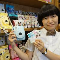 Instant camera gets mojo back with cute focus, Korean push