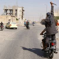 Islamic State militants seize key Syrian air base, trove of weaponry