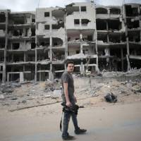 Italian Associated Press video journalist Simone Camilli, 35, is seen Monday in Beit Lahia in the Gaza Strip. He  was among at least five people killed in northern Gaza on Wednesday as sappers were dismantling an Israeli missile. | AFP-JIJI