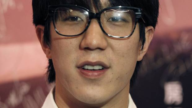 Jackie Chan takes 'bow of apology' after son busted for drugs