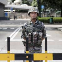 China warns outside forces against meddling in Hong Kong affairs