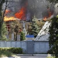A building of Ukrtelecom telephone company is on fire in the eastern Ukrainian city of Donetsk on Sunday. | REUTERS