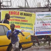 Monrovia slum residents loot Ebola quarantine center, raising fears of virus explosion