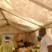 IMedical personnel work Sunday at the Doctors Without Borders facility in Kailahun, Sierra Leone, where Dr. Sheik Humarr Khan, a national hero who risked his own life to treat dozens of Ebola patients, died Tuesday, He had been hospitalized in quarantine. | AP
