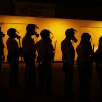 Justice's goal in Ferguson: ensuring truth
