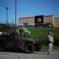 National Guard to withdraw from riot-torn Ferguson as tensions ease