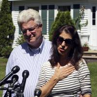 The parents of slain journalist James Foley, Diane and John Foley, talk to reporters Wednesday outside their home in Rochester, New Hampshire, after speaking with President Barack Obama Foley was abducted in November 2012 while covering the Syrian conflict. Islamic militants posted a video showing his murder on Tuesday and said they had killed him because the U.S. had launched airstrikes in northern Iraq. | AP