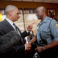 'Change is coming' after police shooting in Ferguson, Holder says