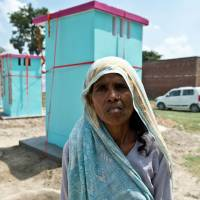 Women in poor Indian village now able to use toilets donated by charity