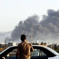 Libyan assembly dissolves militias, asks for U.N. help