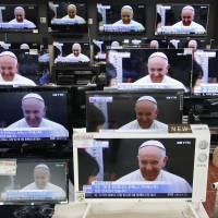 Televisions displayed for sale at an electronics store in Seoul broadcast a news report on Pope Francis' arrival in South Korea on Thursday, the first trip by a pontiff to Asia since 1999 and the first to South Korea in a quarter of a century. | REUTERS