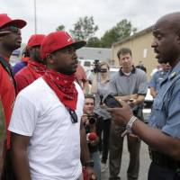 Ferguson-area native tries to keep the peace as curfew is imposed