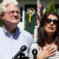 Diane and John Foley talk to reporters Wednesda after speaking with U.S. President Barack Obama outside their home in Rochester, New Hampshire.  Their son, James, was abducted in November 2012 while covering the Syrian conflict. Islamic militants posted a video showing his murder on Tuesday and said they killed him because the U.S. had launched airstrikes in northern Iraq. | AP