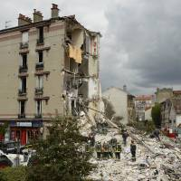 Two die as Parisian building partially collapses following explosion