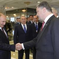 Poroshenko to seek cease-fire after 'very tough' talks with Putin