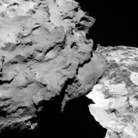 Close-up detail of comet 67P/Churyumov-Gerasimenko appears in this image was taken by Rosetta's OSIRIS narrow-angle camera and downloaded Wednesday. The image shows the comet's 'head' at the left of the frame, which is casting shadow onto the 'neck' and 'body' to the right. The image was taken from a distance of 120 km and the image resolution is 2.2 meters per pixel. A mission to land the first space probe on a comet reaches a major milestone when the unmanned Rosetta spacecraft finally caught up with its quarry on Wednesday. It's a hotly anticipated rendezvous: Rosetta flew into space more than a decade ago and had to perform a series of complex maneuvers to gain enough speed to chase down the comet on its orbit around the sun. | AP
