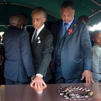 Al Sharpton seizes the moment at Ferguson teen's funeral