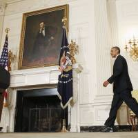 U.S. President Barack Obama walks to a podium in the White House to make a statement about the humanitarian relief situation in Iraq on Thursday. | REUTERS