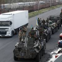 Kiev's forces press attacks on rebel-held areas; Poroshenko to meet Merkel, Putin