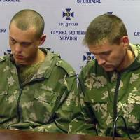 Captured Russian paratroopers are seen in an image taken from video in Kiev on Wednesday. Ten Russian paratroopers were captured last week in Ukraine, adding to a growing body of evidence that Russia, despite its denials, is sending regular troops and weapons to support the separatists in the country. | AP