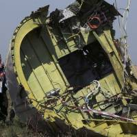 Experts recover more human remains at Ukraine plane crash site
