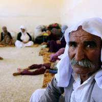Islamic State killed 500 Yazidis and buried some victims alive, Iraq minister says