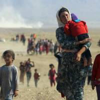 Kurdish fighters create safe passage for Iraqi Yadizis stranded for days on mountain