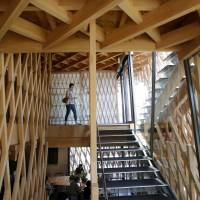 A visitor checks out the interior of the 'Pineapple House,' designed by Kengo Kuma, in Tokyo on July 17. | AP