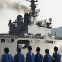The Maritime Self-Defense Force's Shimokita transport vessel departs from its base in Sasebo, Nagasaki Prefecture, bound for the Amami Islands off Kagoshima as part of an island defense drill in May. | KYODO