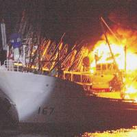 Pair missing after fishing boat catches fire