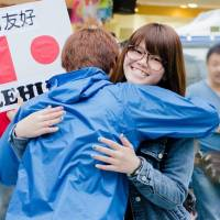 Free Hug activist hopes to mend fences in Asia