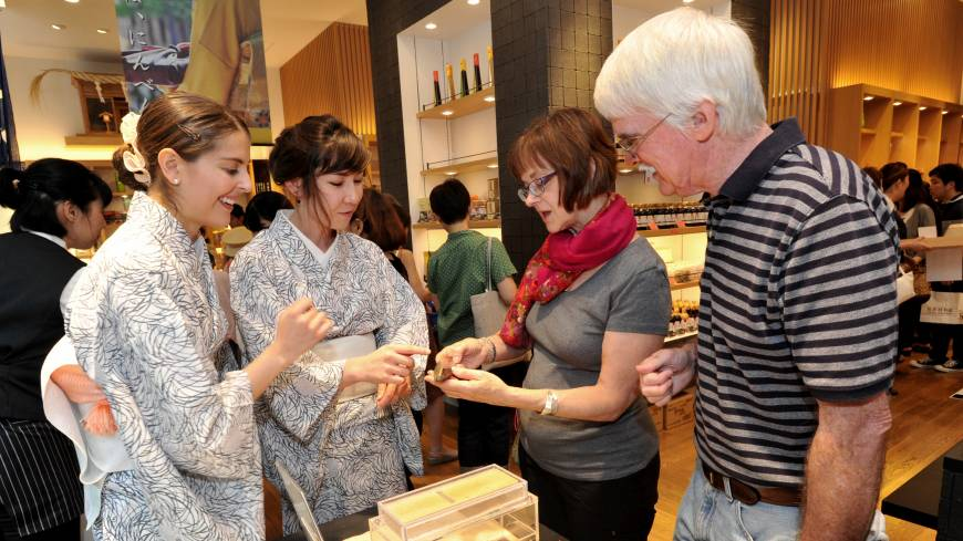 Carter and Free explain dried bonito products to two American tourists.