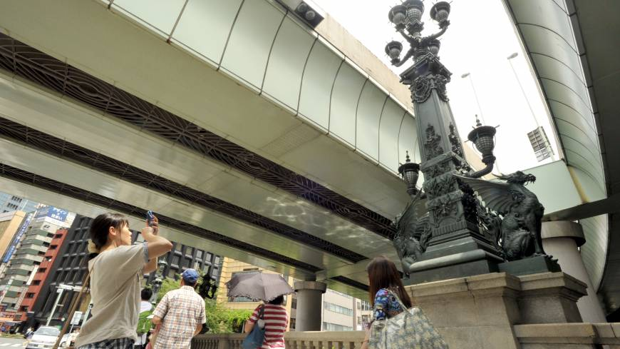 An ornate statue marks the middle of Nihonbashi Bridge, which was a prominent landmark in the capital's development.